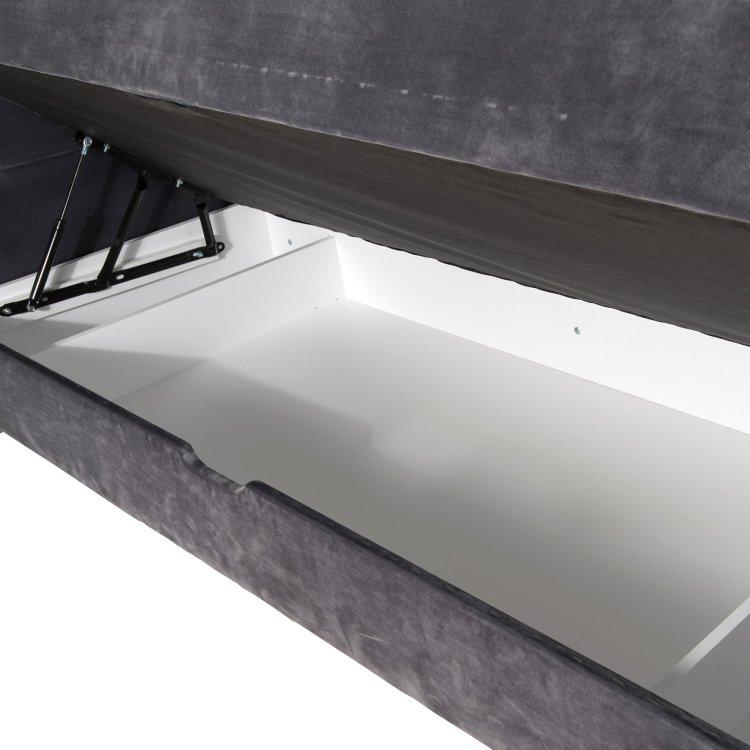 sivi krevet sa sandukom ispod madraca slikan s desne strane